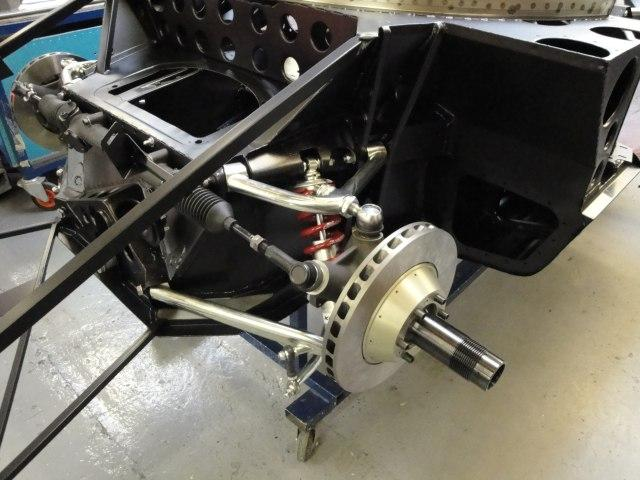 Front Suspension Is Bolted In Place Along With The Rack